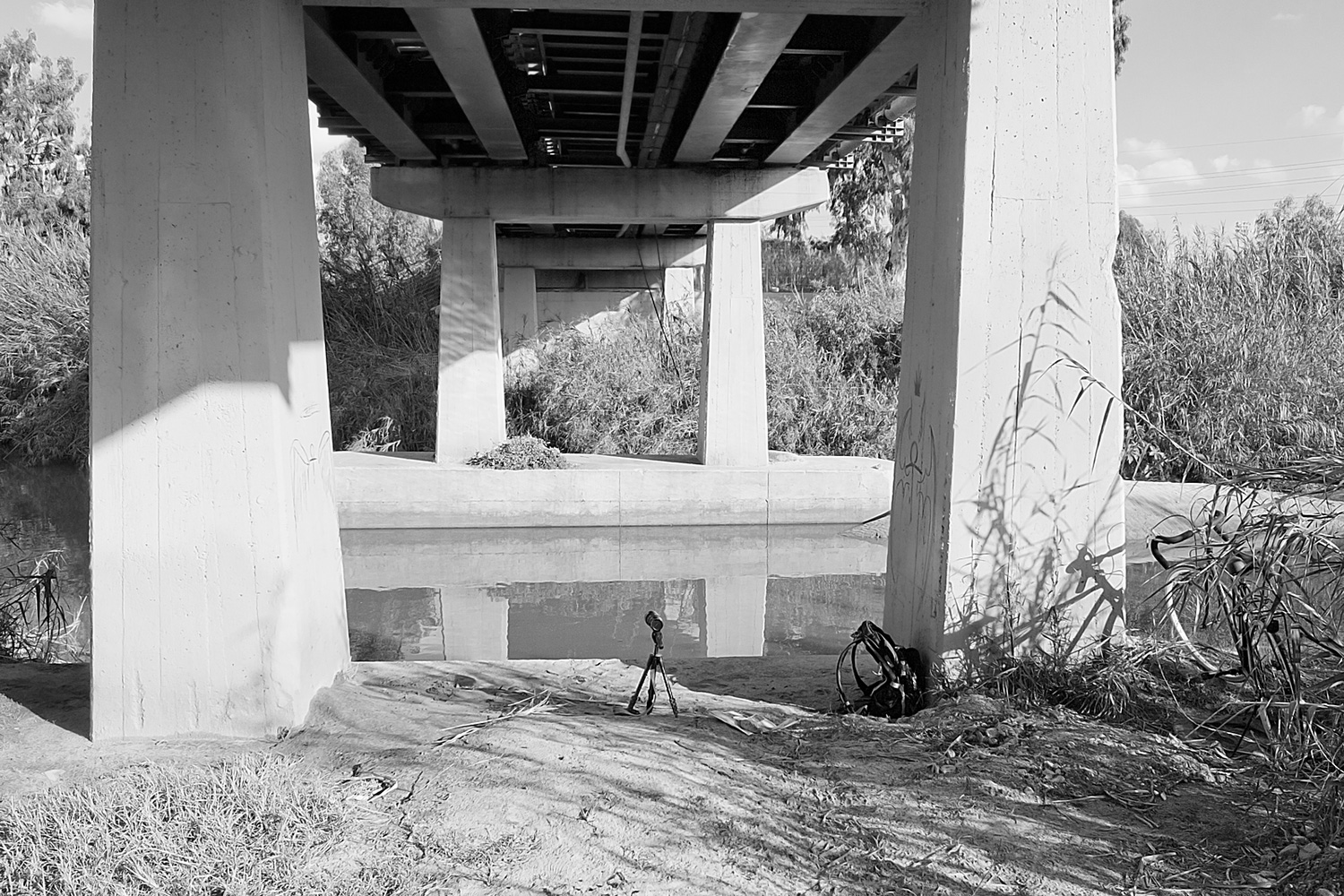 Under the bridge, where it all happened, with the grounsel mound on the other side